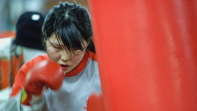 Former North Korean defector Choi Hyun Mi, 14,  beats a sandbag during her training at the Dongbu Unsung Gymnasium in Seoul.