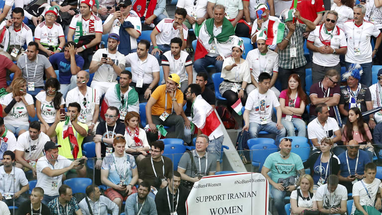 A poster to support Iranian women is displayed in the stands during the group B match between Morocco and Iran at the 2018 soccer World Cup in the St. Petersburg.