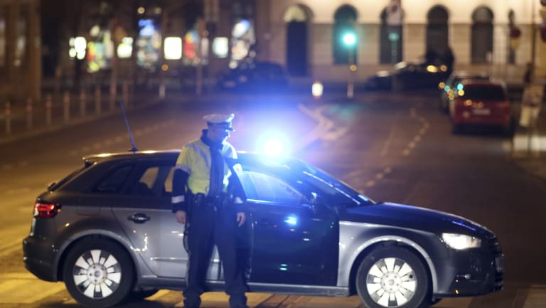 An officer blocks a street during a hunt for the attacker in Vienna.