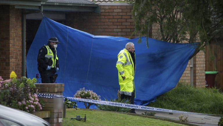 A tarp covered the garage and roller door at the front of the property in Cranbourne North on Saturday.