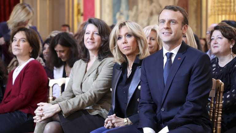 French President Emmanuel Macron, right, and his wife Brigitte Macron, second right, listen to the French Minister for Gender Equality last year.