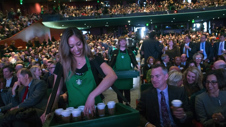 Starbucks employees serve coffee at the annual meeting of shareholders in Seattle in March.