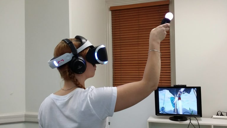 A Stirfire Studios employee playing virtual reality game Symphony of the Machine, which was developed in WA.