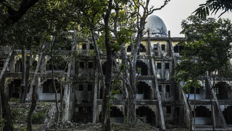 An abandoned building at the ashram formerly run by Maharishi Mahesh Yogi has been  swallowed by the forest.