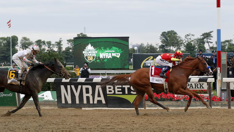 Superior: Justify carries the China Horse Club silks to victory in the Belmont Stakes to complete the Triple Crown.