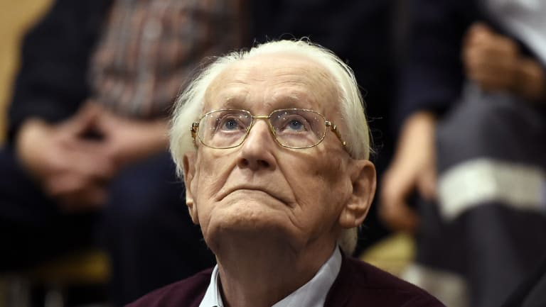 Former SS sergeant Oskar Groening looks up as he listens to the verdict of his trial at a court in Lueneburg, northern Germany, in 2015.