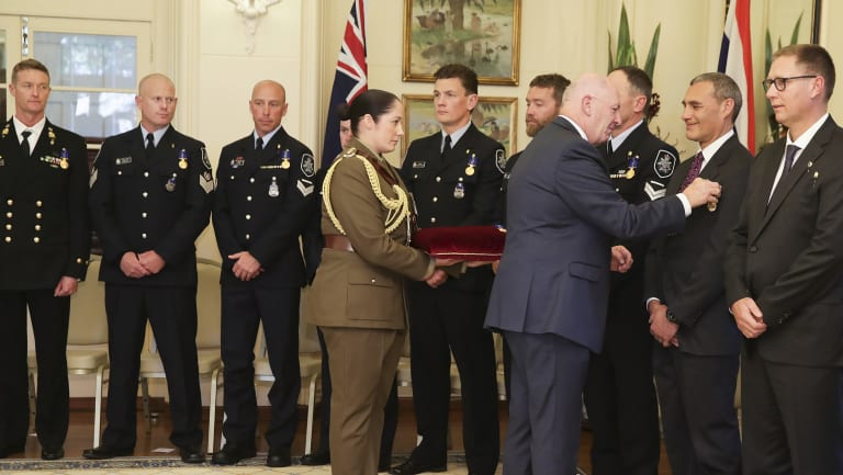 Chief Petty Officer Troy Eather, acting Station Sergeant Robert James, Leading Senior Constable Kelly Boers, Detective Leading Senior Constable Benjamin Cox, First Constable Matthew Fitzgerald, Senior Constable Justin Bateman, Detective Leading Senior Constable Christopher Markcrow, Dr Craig Challen and Dr Richard Harris are presented with the Medal of the Order of Australia (OAM) by Governor-General Sir Peter Cosgrove for their role in the Tham Luang cave rescue operation.