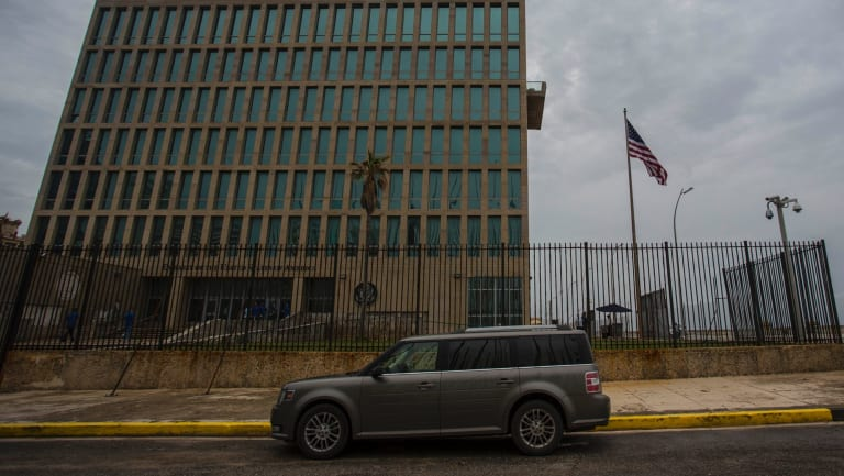 A car is parked outside the compound of the United States embassy in Havana, Cuba.