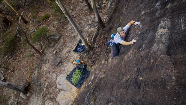 David Ralphs climbs The Bandoline Grip on the Upper Shipley crag in Blackheath while his wife Bronwyn belays.