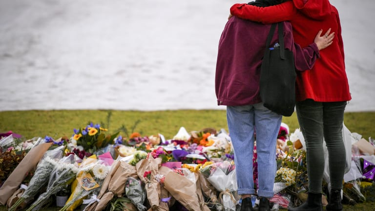 Mourners at the make shift memorial where Eurydice Dixon's body was found at the Princes Park, North Carlton.