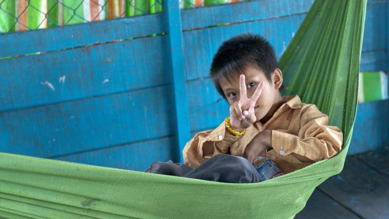 An unamed orphan at Tonle Sap lake, near Siem Reap, Cambodia, in 2013.