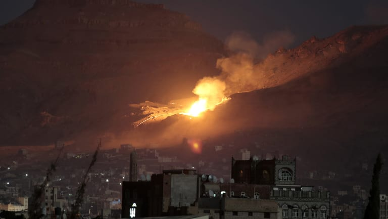 Fire and smoke rise after a Saudi-led air strike hit a site believed to be one of the largest weapons depots on the outskirts of Sanaa in October 2016.