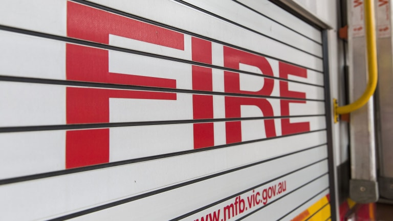 A Queensland fire inspector has been suspended from the service after he was charged with official corruption.
