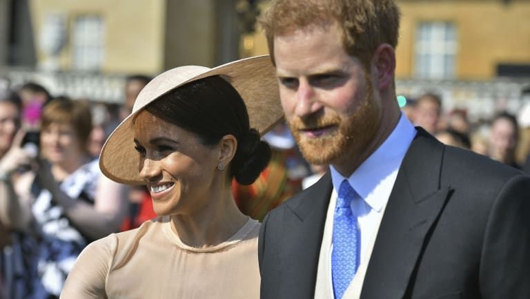 Meghan, the Duchess of Sussex, and her husband, Prince Harry, attend a garden party at Buckingham Palace for Prince Charles 70th birthday last month.