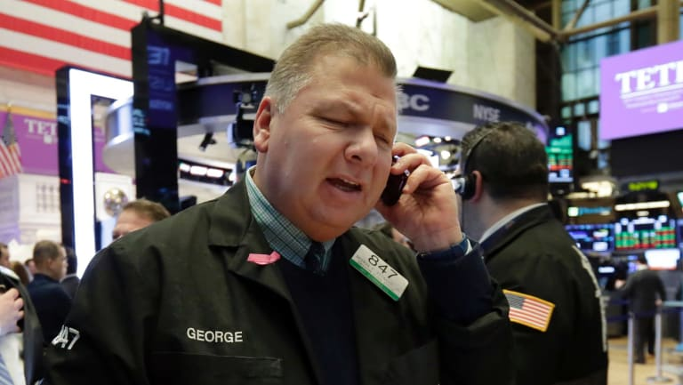 Wall Street ended lower on a high volume day.