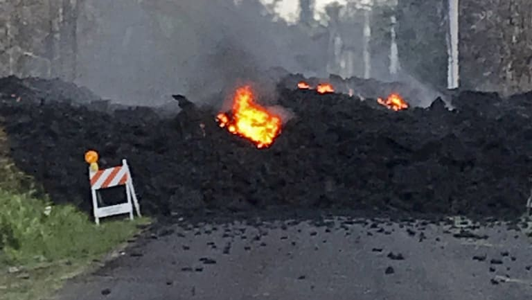 Lava flowing over Mohala Street in the Leilani Estates on the Big Island of Hawaii.