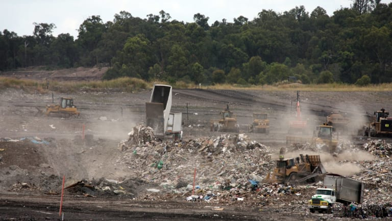 Queensland waste trucks dump unprocessed construction waste from NSW at Cleanaway's New Chum landfill in Ipswich after it has passed through Cleanaway's recycling facility at Willawong in January.