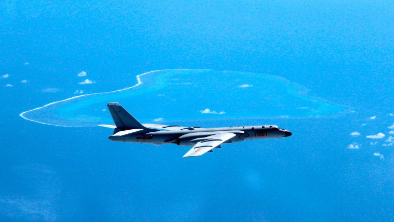 A Chinese H-6K bomber patrols the islands and reefs in the South China Sea - which has been a source of tension with neighbour Vietnam.