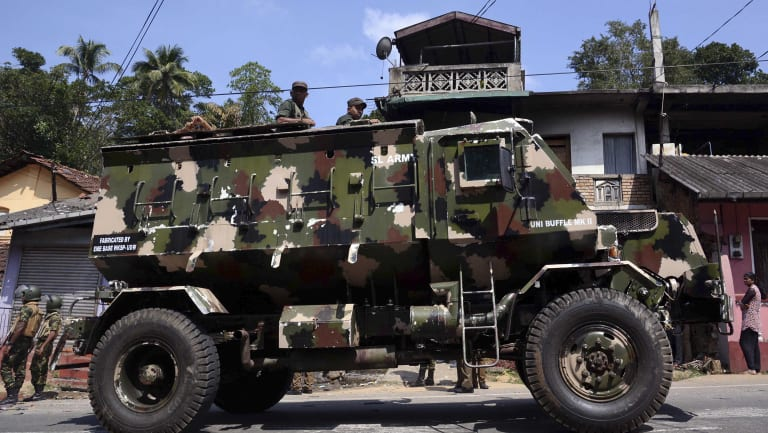 Sri Lankan army soldiers look on from an armed personnel carrier in Digana, a suburb of Kandy.