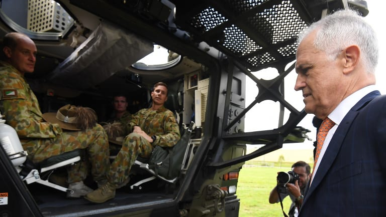 Mr Turnbull inspects a Boxer armoured vehicle at Enoggera Barracks.