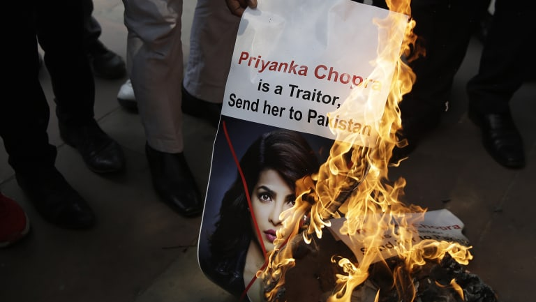 Activists of ultra right-wing Hindu Sena or Hindu Army burn posters featuring photographs of Indian actress Priyanka Chopra during a protest in New Delhi last week.