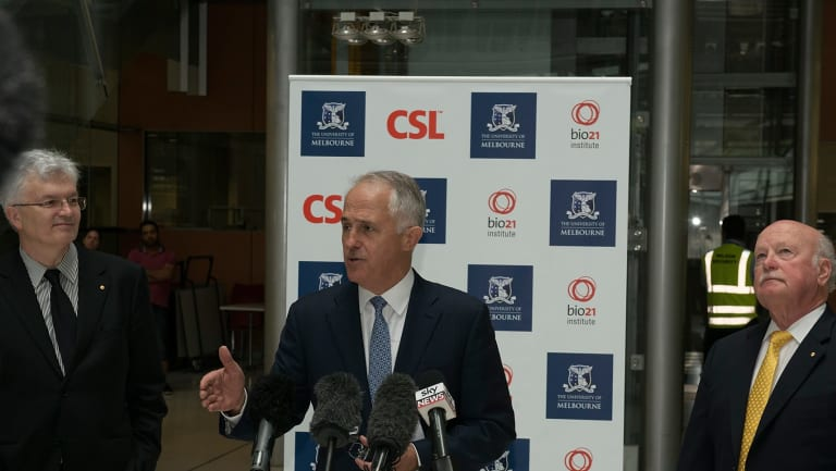 Glyn Davis (left) and Malcolm Turnbull (centre) jousted over industry collaboration last year. Pictured with CSL chairman John Shine at the announcement of a 5000-square-metre expansion of the university's  Bio21 Molecular Science and Biotechnology Institute