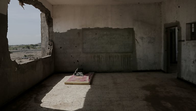 War damage inside a classroom of a school now turned into a camp for displaced persons in Khanfar, Abyan, Yemen.