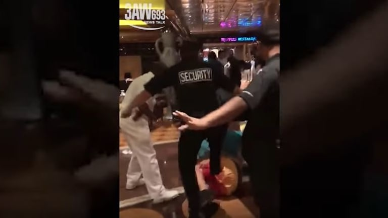 Mobile phone footage shows security guards kicking a passenger during the fight.