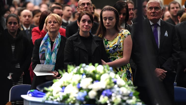 Brett Forte's wife Susan and daughter Emma at his funeral in Toowoomba last June.