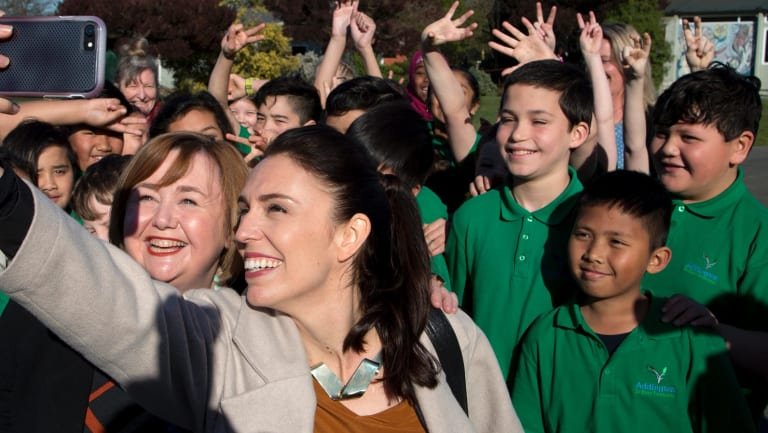 New Zealand Labour Party leader Jacinda Ardern, front right, takes a selfie with school children in Christchurch.