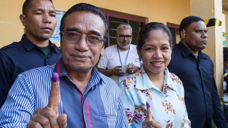 East Timorese Francisco 'Lu'Olo' Guterres, left, shows his finger to indicate he has just voted in parliamentary elections in July.