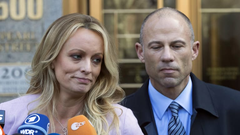 Stormy Daniels, pictured with her lawyer Michael Avenatti.