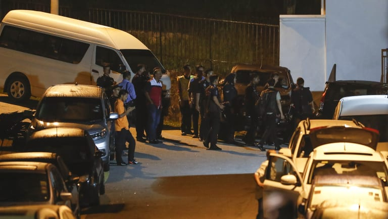 Police gather at the resident of former Prime Minister Najib.