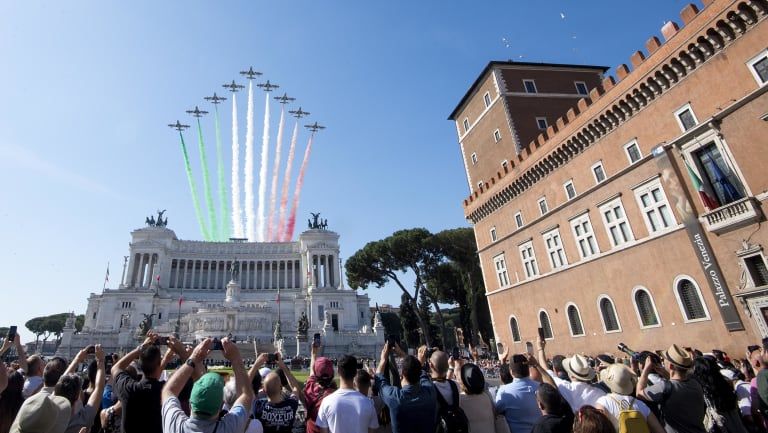 The Frecce Tricolori Italian Air Force acrobatic squad flies over the monument to the unknown soldier on the occasion of the 72nd anniversary of the Italian Republic in Rome.