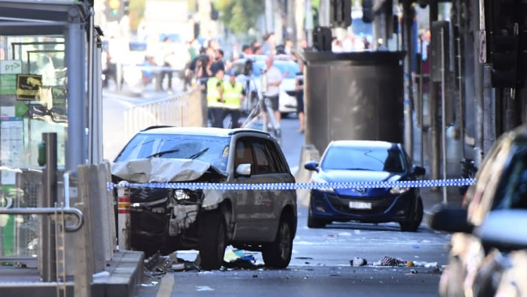 A damaged vehicle is seen at the scene of an incident on Flinders Street, in Melbourne, Thursday, December 21, 2017. A vehicle has ploughed into pedestrians in central Melbourne. (AAP Image/Joe Castro) NO ARCHIVING