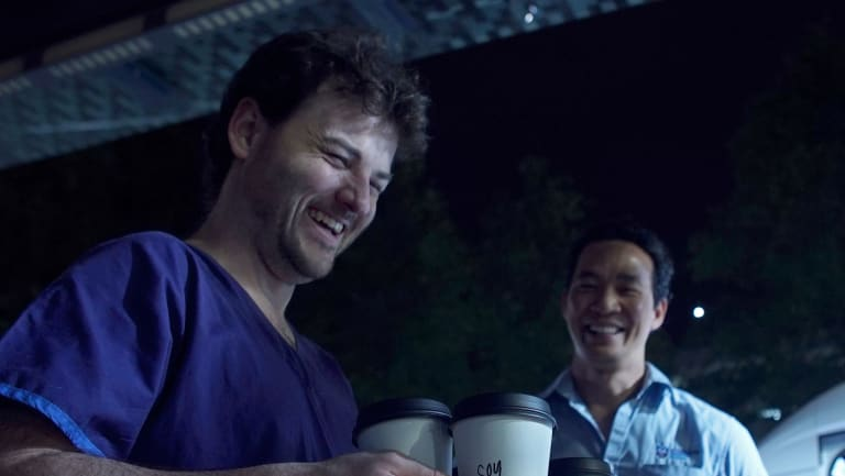Two night shift workers at St Vincent's hospital collect their coffees on a quick break.