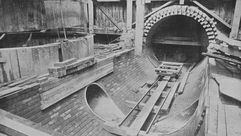 This image, taken sometime between 1893 and 1897 of a sewer pipe nearby, shows the original brick construction methods.