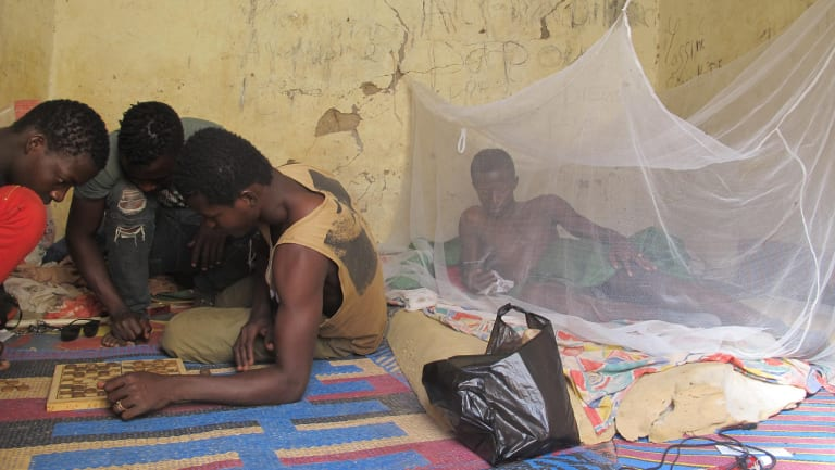 Teen migrants rest in a compound in Agadez, Niger, in December.