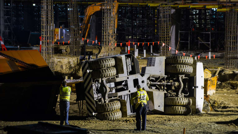 Police, paramedics, and WorkSafe on the University of Canberra Hospital construction site, where a crane is lying on its side after the August 2016 incident.