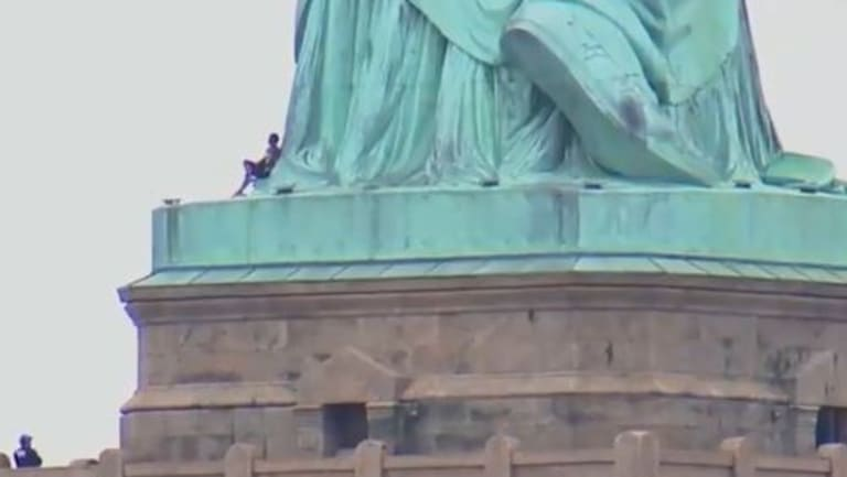 The female protester scaled the iconic landmark on Independence Day in the US.