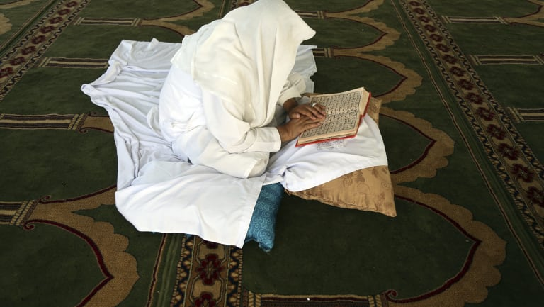 An Afghan Muslim man reads versus of the Quran in a mosque during Itikaf, the last ten days of the Islamic fasting month of Ramadan, in Kabul, Afghanistan.