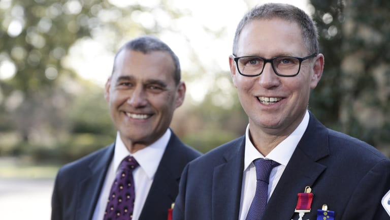 """Just two ordinary blokes"": Craig Challen and Richard Harris were awarded for their bravery in the Thai cave rescue."