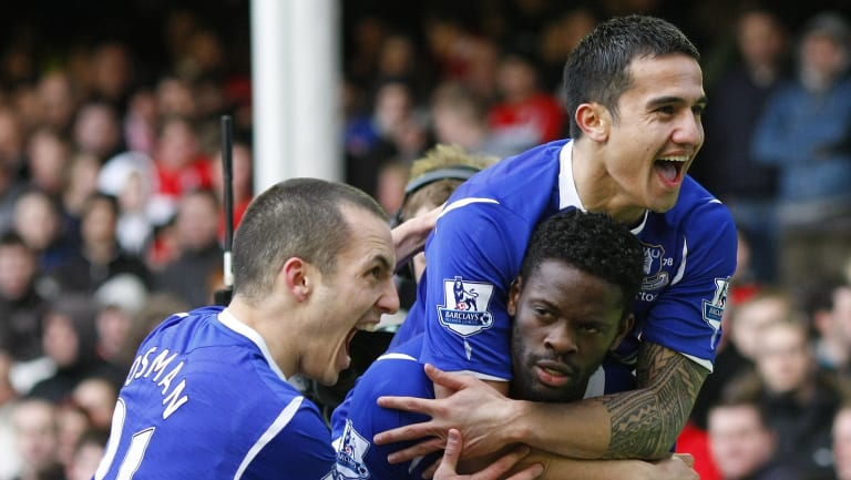 Everton's Louis Saha (bottomR) celebrates with Tim Cahill (top R) and Leon Osman after scoring during their FA Cup quarter-final in 2009.