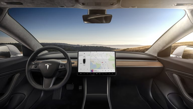 In Tesla's Model 3, the 15-inch touchscreen is a focal point. The touchscreen looks great, but can be distracting as most functions, including the windshield wipers and cruise control speed, are operated from it.