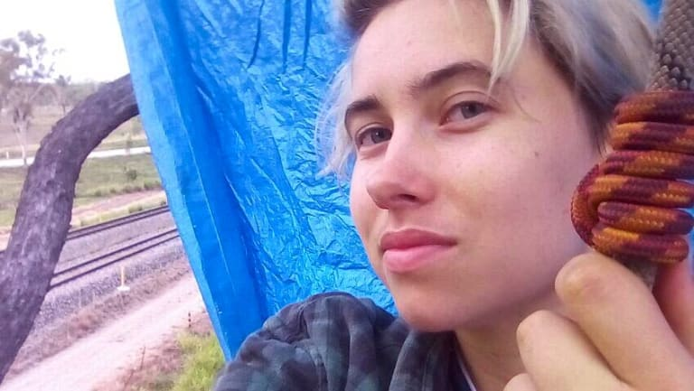 Tayla Jay Haggarty, from Frontline Action on Coal, was arrested after allegedly suspending herself from ropes, attached to a coal rail line.