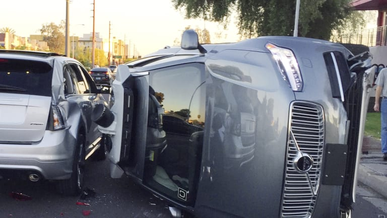 An Uber self-driving car that flipped on its side in a collision in Arizona.