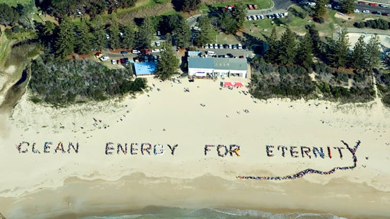 Tathra has long been a focus of climate change and renewable energy support, as seen in this beach sign with 3000 people in 2006.