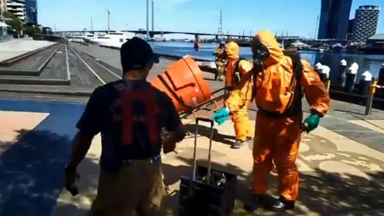 Hazmat officers remove the canisters from Docklands.