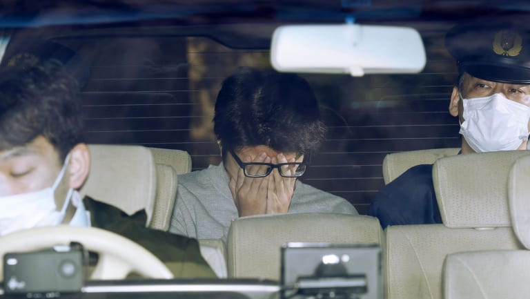 """Takahiro Shiraishi, dubbed the """"Twitter Killer"""", leaves a Tokyo police station to face prosecutors in November."""
