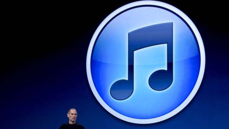 Apple in negotiations for unlimited music downloads: sources